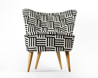 Completely restored Black and White cocktail chair from 1970's