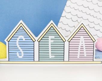 Beach house shelf decor. Pastel themed.