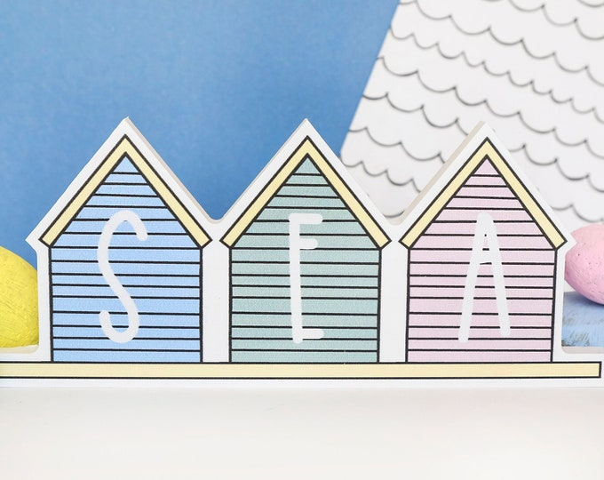 Beach house shelf decor. Pastel themed.