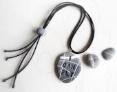 Engraved beach stone neck...