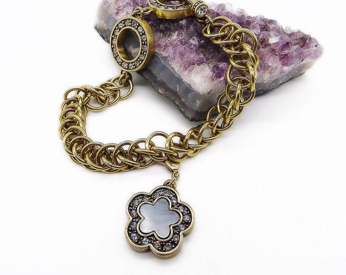 Retired Heidi Daus antiqued brass mother of pearl Swarovski Crystal encrusted signed toggle charm bracelet