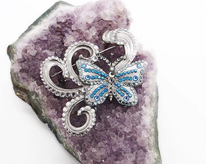 Amazing vintage Anne Koplik Designs silver tone faceted crystal decorative swirl signed Butterfly brooch