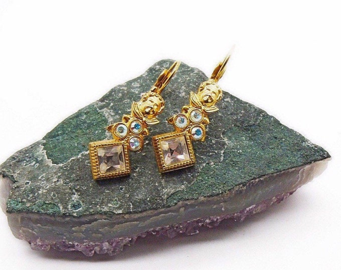Kirks Folly vintage retired brilliant gold tone faceted Aurora Borealis Swarovski Crystal signed Cherub lever back earrings