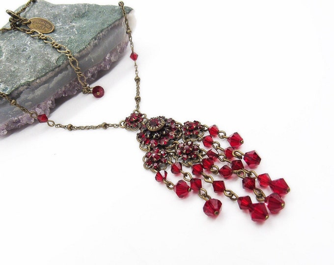 Gorgeous Liz Palacios vintage retired antiqued gold tone cascading faceted ruby crystal signed statement necklace