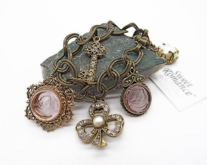 Vintage Sweet Romance USA Victorian Revival antiqued bronze and brass Pink Glass Intaglio faceted Crystal pearl signed Charm bracelet
