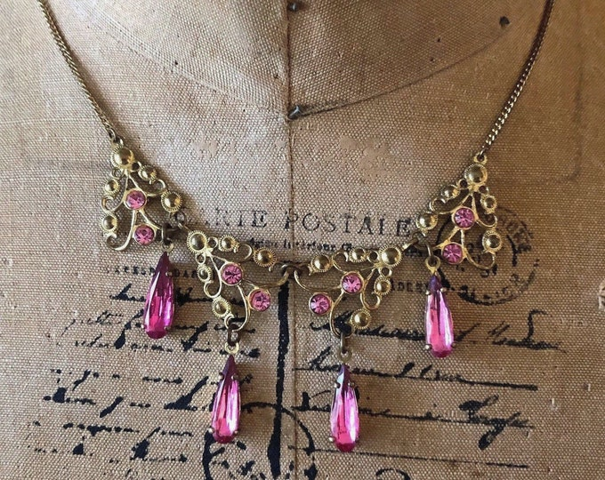 Ethereal antique Victorian Aesthetic gold rolled base metal faceted Rose Pink Paste Rhinestone accented ornate Drop Bib Necklace