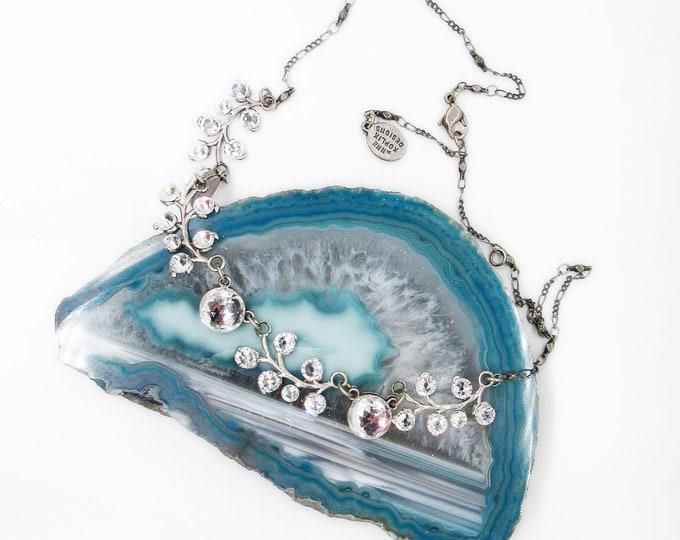 Anne Koplik designs charming silver tone  floral design brilliant Swarovski crystals signed bib necklace