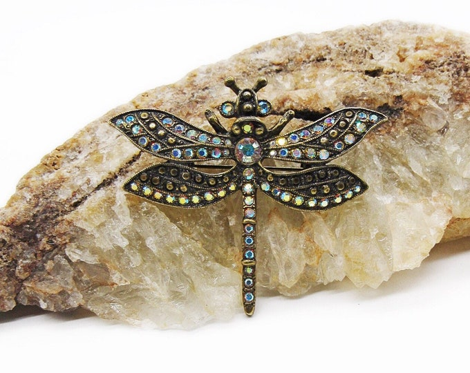 Whimsical Kirks Folly Vintage antiqued brass tone faceted Aurora Borealis Crystal signed Dragonfly brooch