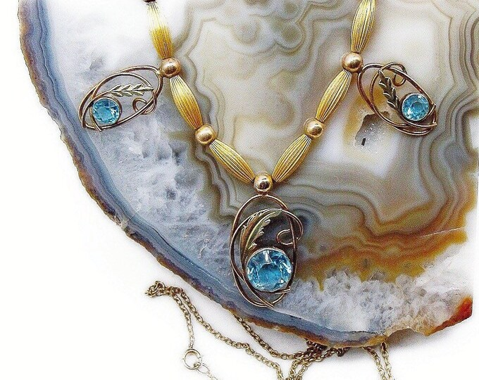 1940s Mid Century Gold Plated faceted Topaz Blue Rhinestone accented elegant long Necklace