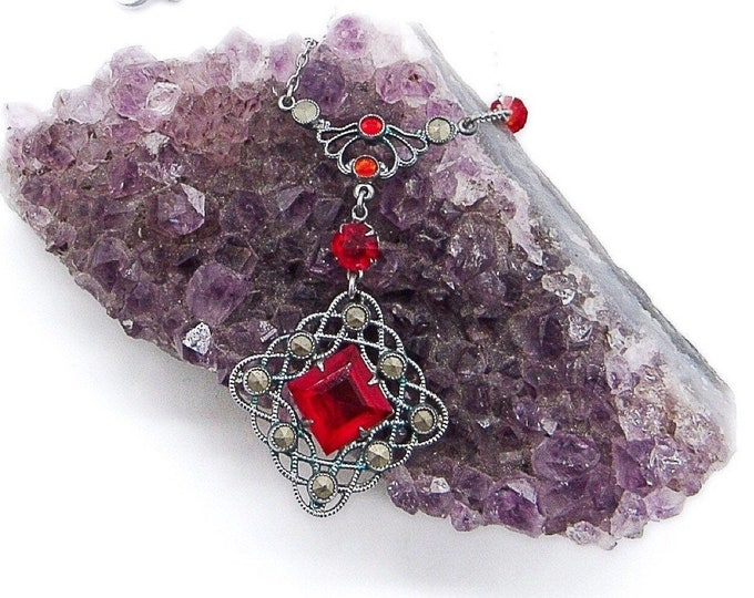 Ornate vintage Art Deco Rhodium plated filigree lavaliere necklace with Ruby red open back glass stones circa 1920-30s