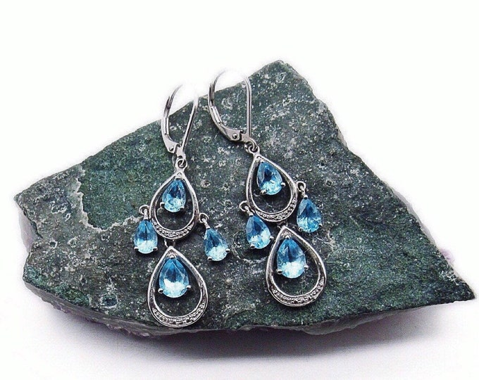Beautiful vintage Sterling Silver faceted Topaz Blue Crystal drop signed lever back chandelier earrings