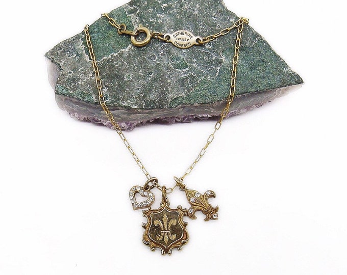 Catherine Popesco of France Vintage antiqued gold plated faceted Crystal accented Fleur De Lis and Heart signed Charm necklace