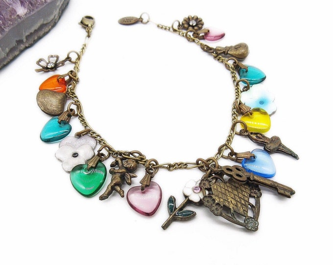 Vintage Anne Koplik Designs Victorian revival antiqued brass hearts of glass enamel and brass signed charm bracelet