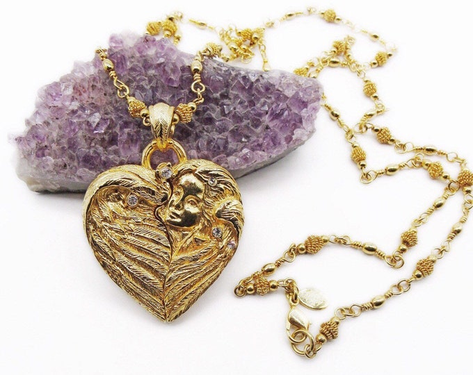 Magical vintage Kirks Folly Rare Brilliant gold tone faceted Swarovski Crystal Repousse Women winged Cameo Heart Locket
