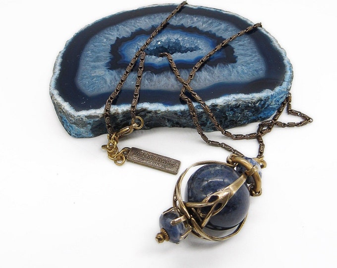 Jan Michaels of San Francisco retired Art Nouveau design brass and Lapis stone cage pendant necklace