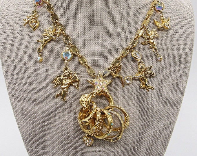 "Vintage Kirks Folly ""Secrets of the Seven Angels"" gold plated Swarovski crystal and seed pearl Angel charm signed necklace"