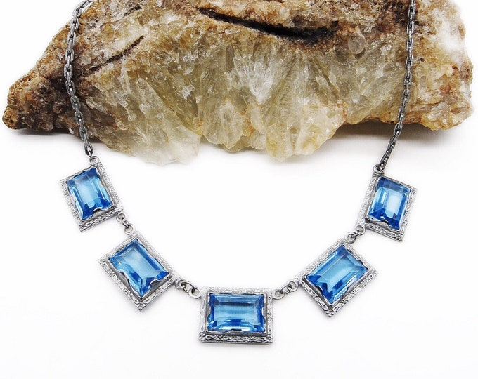 1930s Vintage Art Deco Rhodium plated faceted emerald cut Topaz blue Crystal bib necklace