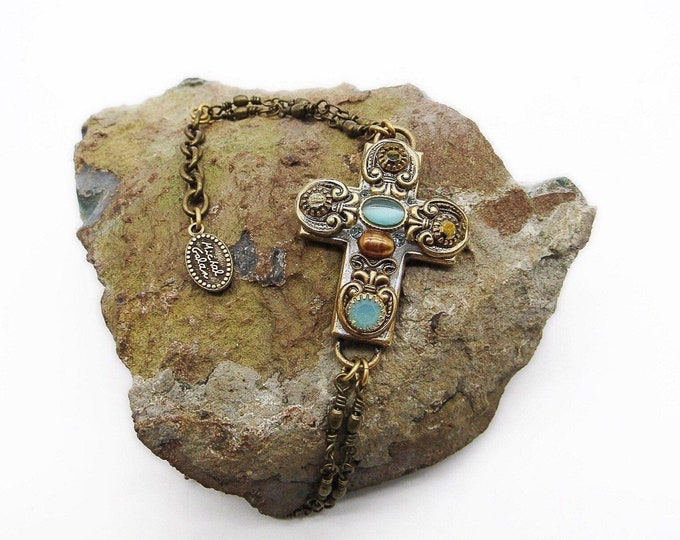 Michal Golan vintage handcrafted antiqued bronze tone with gold plating Royal light blue cats eye and faceted crystal Cross chain bracelet