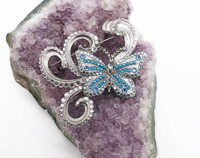 Amazing vintage Anne Koplik Designs silver tone faceted crystal decorative swirl signed Butterfly brooch