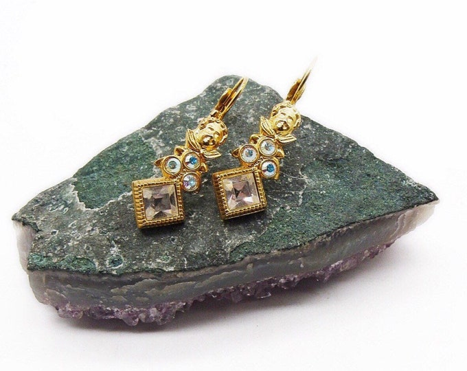 Kirks Folly vintage retired brilliant gold tone faceted Aurora Borealis Swarovski Crystal signed Cherub lever back earrings
