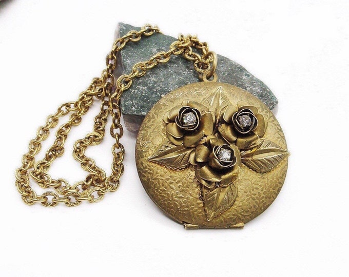 Vintage Lenora Dame antiqued gold tone faceted crystal floral accented large embossed locket pendant necklace