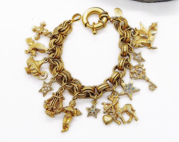 Kirks Folly vintage matte gold tone triple loop chain whimsical signed charm bracelet