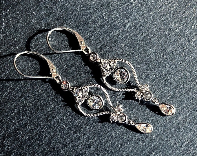 Dazzling vintage 10K White Gold brilliant sparkling faceted Cubic Zirconium accented signed pierced Dangle Earrings