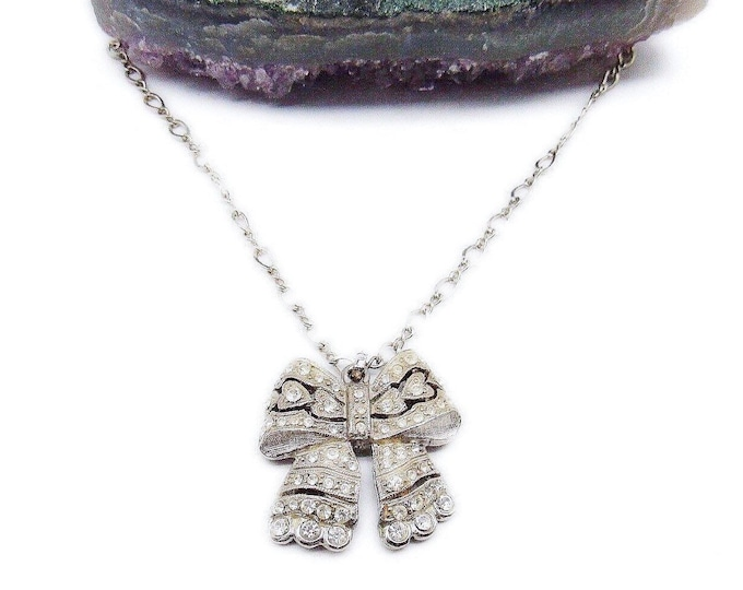 Beautiful Roxanne Assoulin vintage Edwardian Revival silver tone faceted Paste Rhinestone accented Bow Designer Pendant Necklace