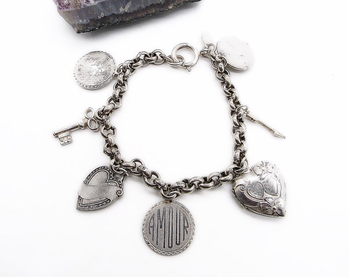 Catherine Popesco La Vie Parisienne vintage Victorian revival silver plated Heart Locket and charms signed bracelet