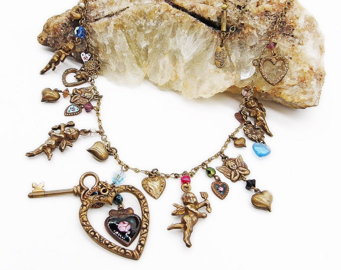 Rare 1980s Pididdly Links Ltd vintage Victorian revival antiqued brass tone faceted crystal enamel hearts and Cherub signed charm necklace