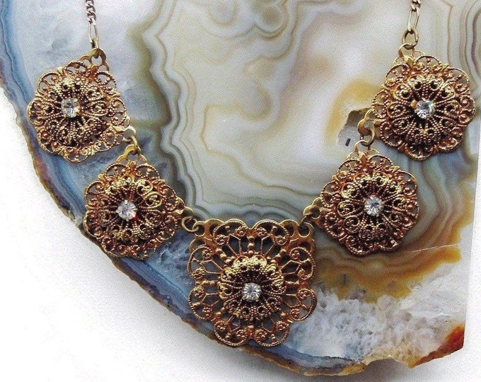 Decorative Sadie Green vintage Victorian Revival antiqued brass tone faceted white Crystal accented signed Designer Bib Necklace
