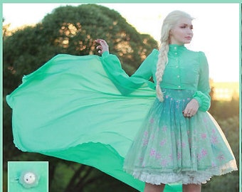 Mint blouse with hem at the back + gift