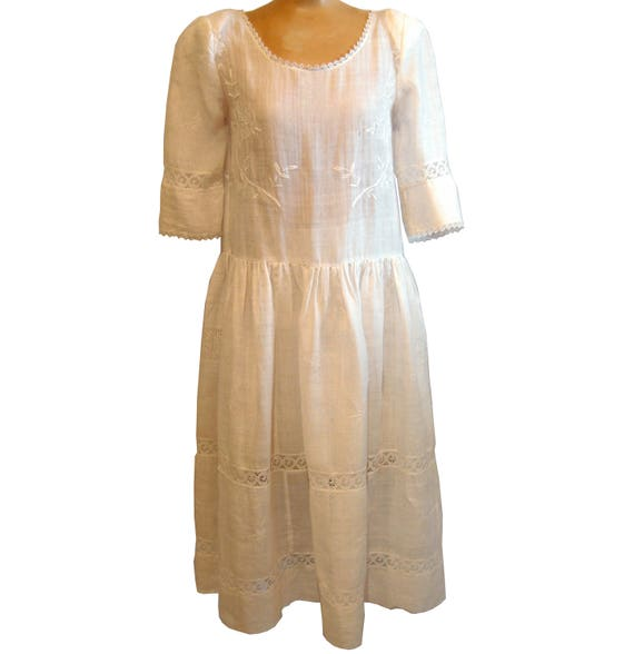 Embroidered white linen drop-waist dress made from