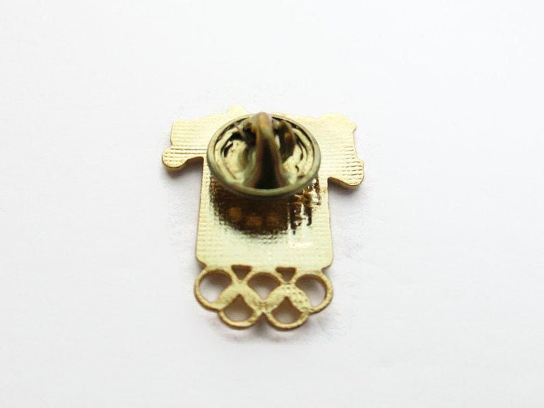 1984 Summer Games Gold Cut Out Rings Perrier Water Vintage Olympic Pin Runner  Sprinter Los Angeles California USA