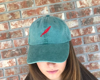2b18499ef44 Disney inspired embroidered Peter Pan feather baseball hat