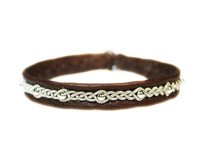 No. 1033: Sami Bracelet of pewter thread, pearls of sterling silver and reindeer leather.