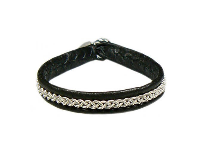 No. 1126: Sami Bracelet of pewter thread and reindeer leather.