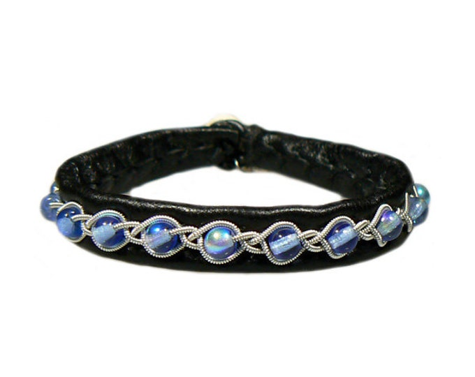 No. 1064: Sami Bracelet of pewter thread, colored pearls of glass and reindeer leather.