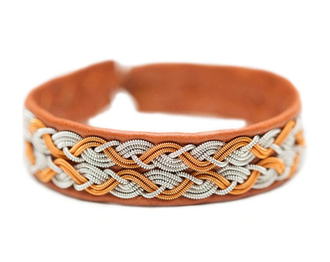 No. 1068: Sami Bracelet of pewter thread, copper thread and reindeer leather.