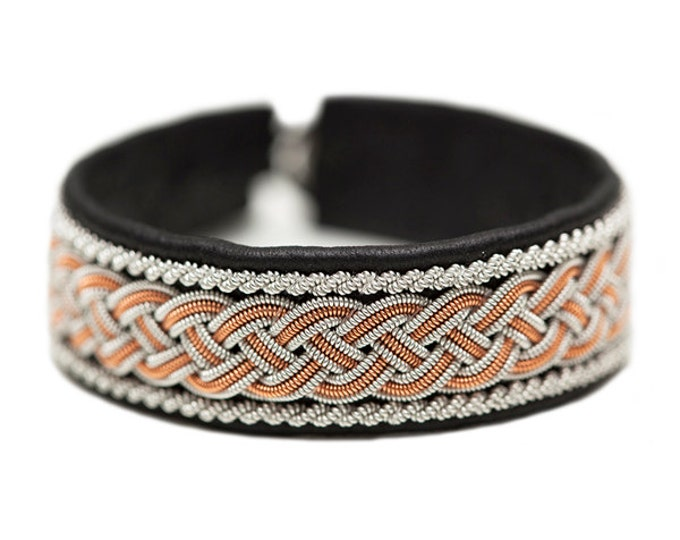 No. 1027: Sami Bracelet of pewter thread, colored copper thread and reindeer leather.
