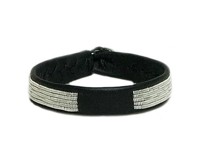 No. 1138 Thin: Sami Bracelet of flat pewter thread and reindeer leather.