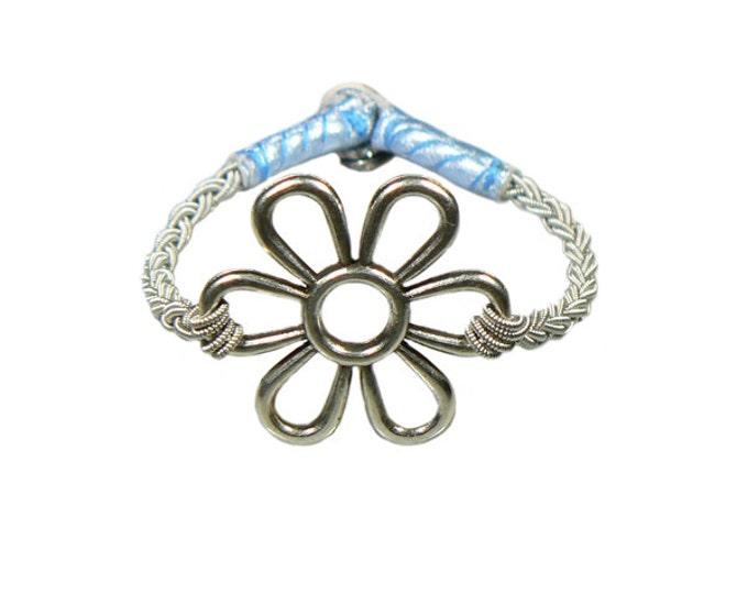 No. 1112 Flower:  Sami Bracelet of pewter thread, metal badge, and reindeer leather.