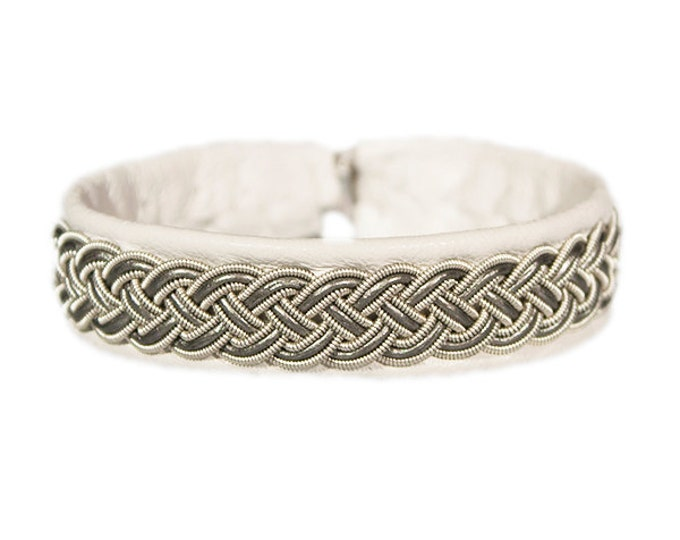 No. 1014: Sami Bracelet of pewter thread and reindeer leather.