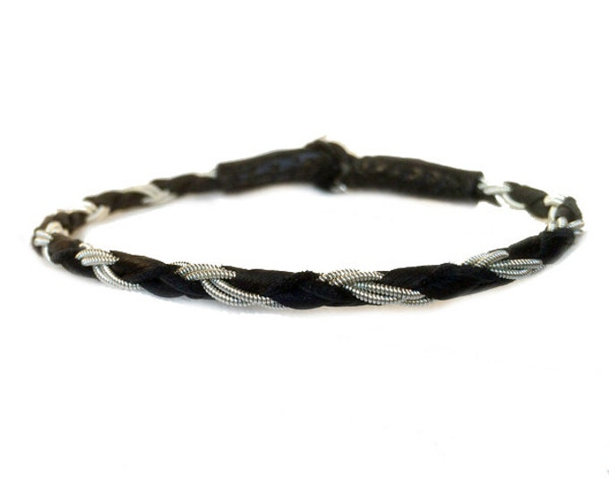 No. 1001: Sami Bracelet of pewter thread and reindeer leather.