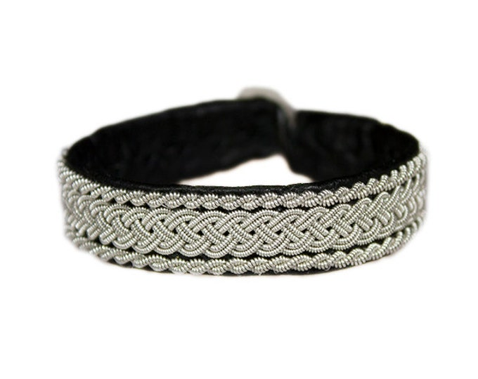 No. 1011: Sami Bracelet of pewter thread and reindeer leather.