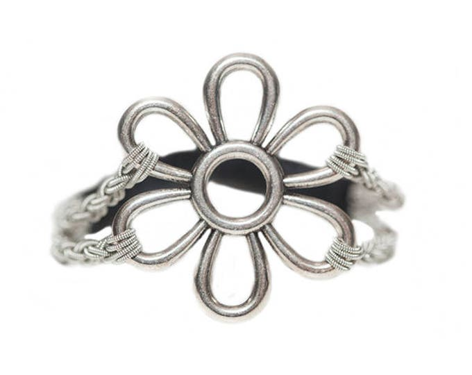 No. 1112 Large Flower:  Sami Bracelet of pewter thread, metal badge, and reindeer leather.