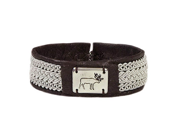 No. 1134 Reindeer: Sami Bracelet of pewter thread, pewter badge and reindeer leather.