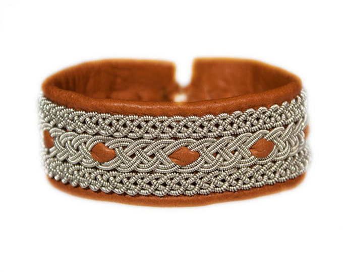 No. 1041: Sami Bracelet of pewter thread and reindeer leather.