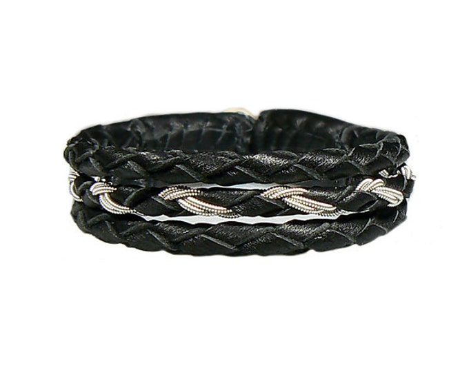 No. 1097: Sami Bracelet of pewter thread and reindeer leather.