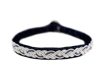 No. 1049: Sami Bracelet of pewter thread, copper thread and reindeer leather.